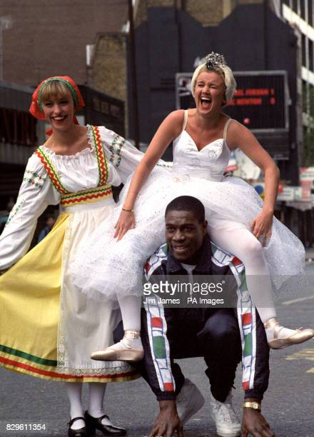 Boxer Frank Bruno frolics with TV personalities Michaela Strachen and Lisa Maxwell outside the Dominion Theatre where the threesome were rehearsing...