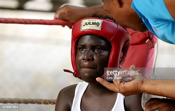 A boxer his tears in his eyes as he sits in his corner during a fight at Rafael Trejo Boxing Gym on May 8 2015 in Havana Cuba The Rafael Trejo Boxing...