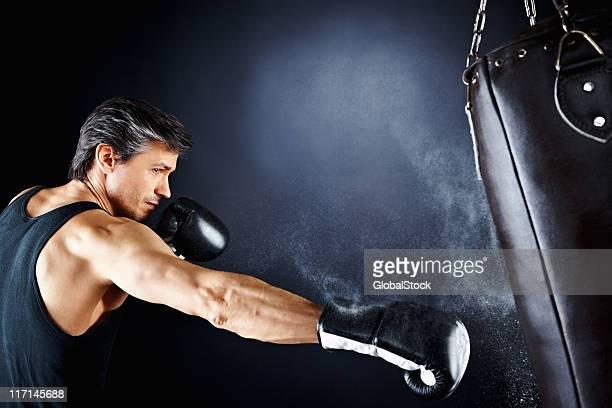 Boxer hitting punching bag