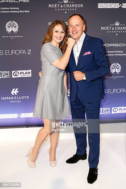 Boxer Ina Menzer and Klaus J Pojer CEO HapagLloyd Cruises attend the Fashion2Night event at EUROPA 2 on August 23 2016 in Hamburg Germany