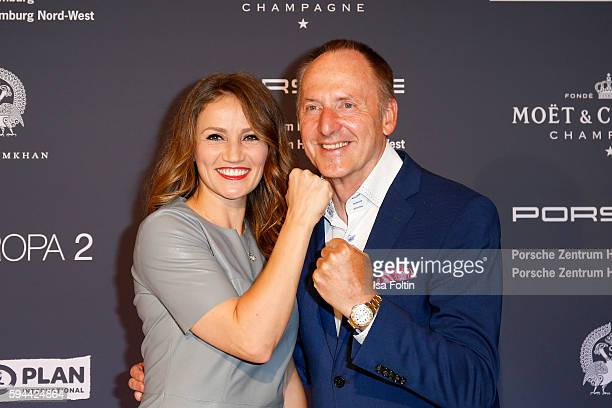 Boxer Ina MoosMenzer and Karl J Pojer CEO HapagLloyd Cruises attend the Fashion2Night event at EUROPA 2 on August 23 2016 in Hamburg Germany