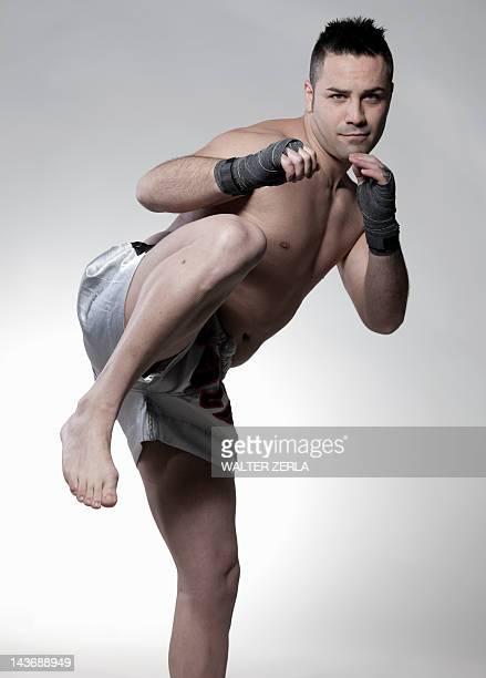 Boxer jabbing and kicking
