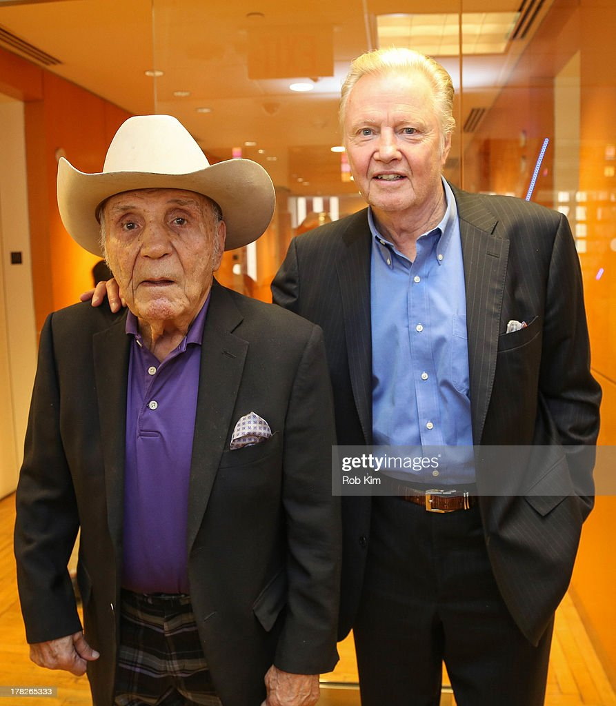 Boxer Jake LaMotta (L) and actor Jon Voight visit at SiriusXM Studios on August 28, 2013 in New York City.