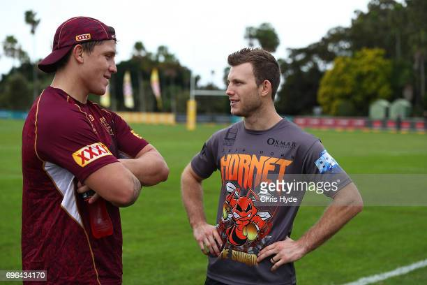 Boxer Jeff Horn talks with Jarrod Wallace during a visit to the Queensland Maroons State of Origin team during a training session at Intercontinental...