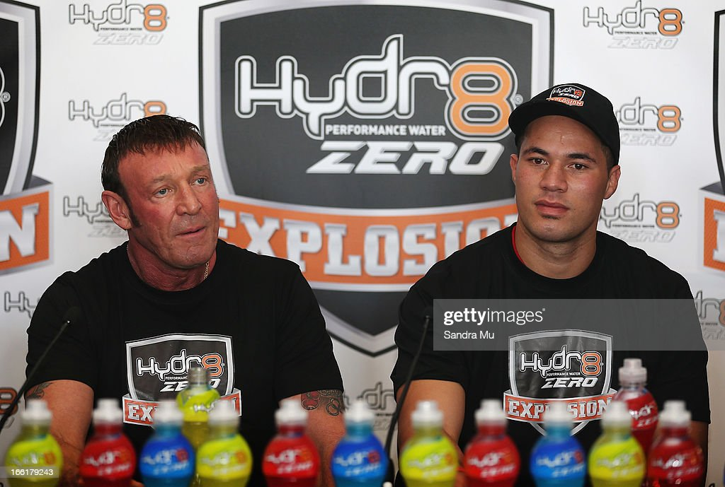 Boxer Joesph Parker (R) addresses the media with his new trainer Kevin Barry during the Hydr8 Zero Explosion Press Conference at Northern Steamship Bar on April 10, 2013 in Auckland, New Zealand.