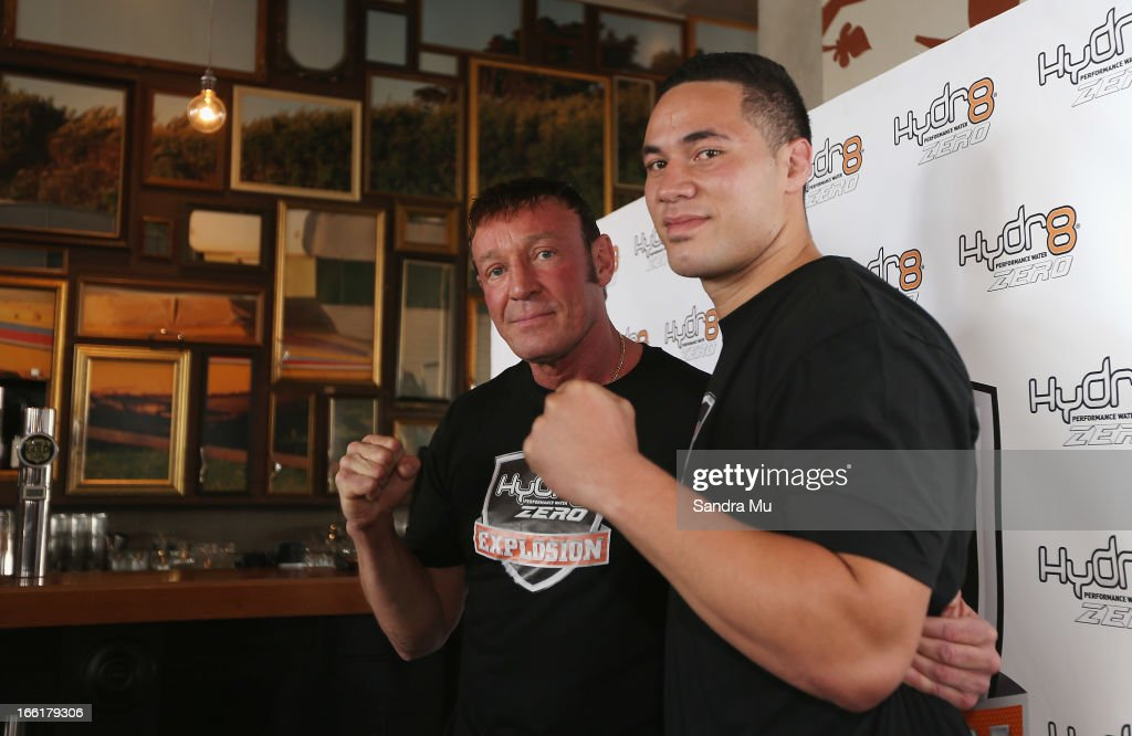 Boxer Joesph Parker (R) poses with his new trainer Kevin Barry during the Hydr8 Zero Explosion Press Conference at Northern Steamship Bar on April 10, 2013 in Auckland, New Zealand.