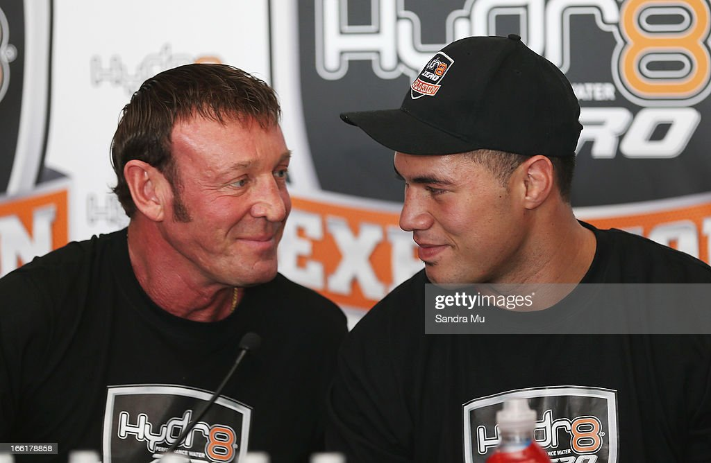 Boxer Joesph Parker (R) talks with his new trainer Kevin Barry during the Hydr8 Zero Explosion Press Conference at Northern Steamship Bar on April 10, 2013 in Auckland, New Zealand.