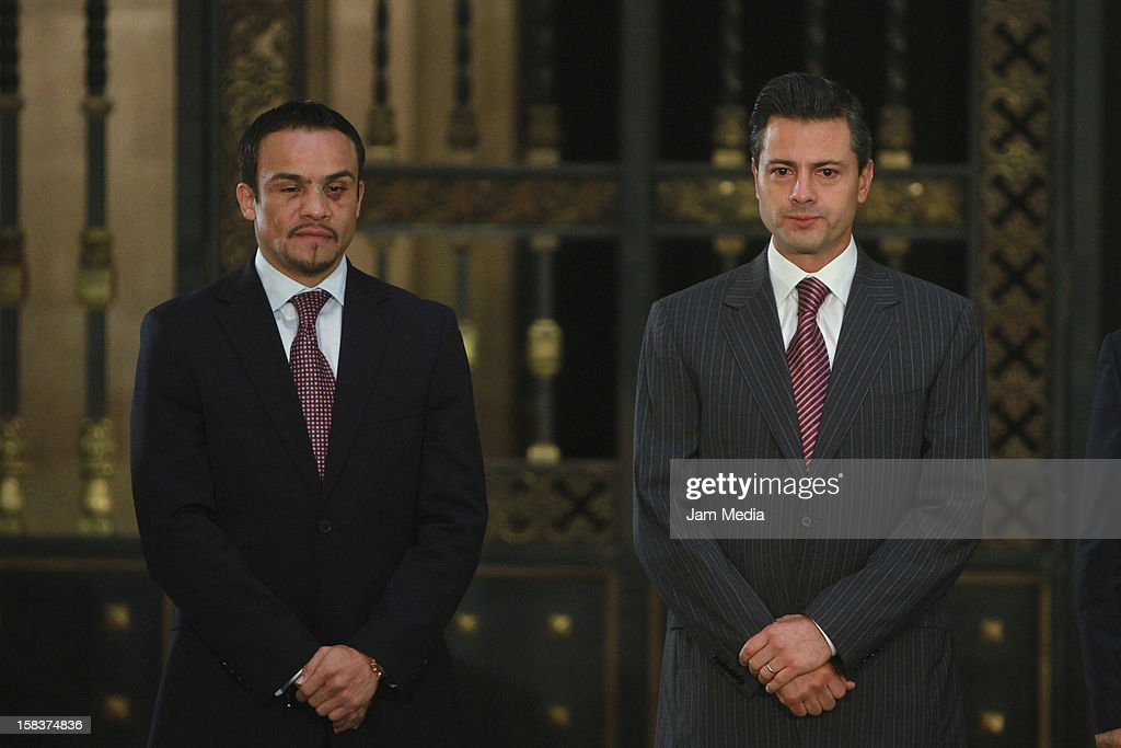 Boxer Juan Manuel Marquez and the President of Mexico Enrique Peña Nieto pose at Palacio Nacional on December 14, 2012 in Mexico City, Mexico.