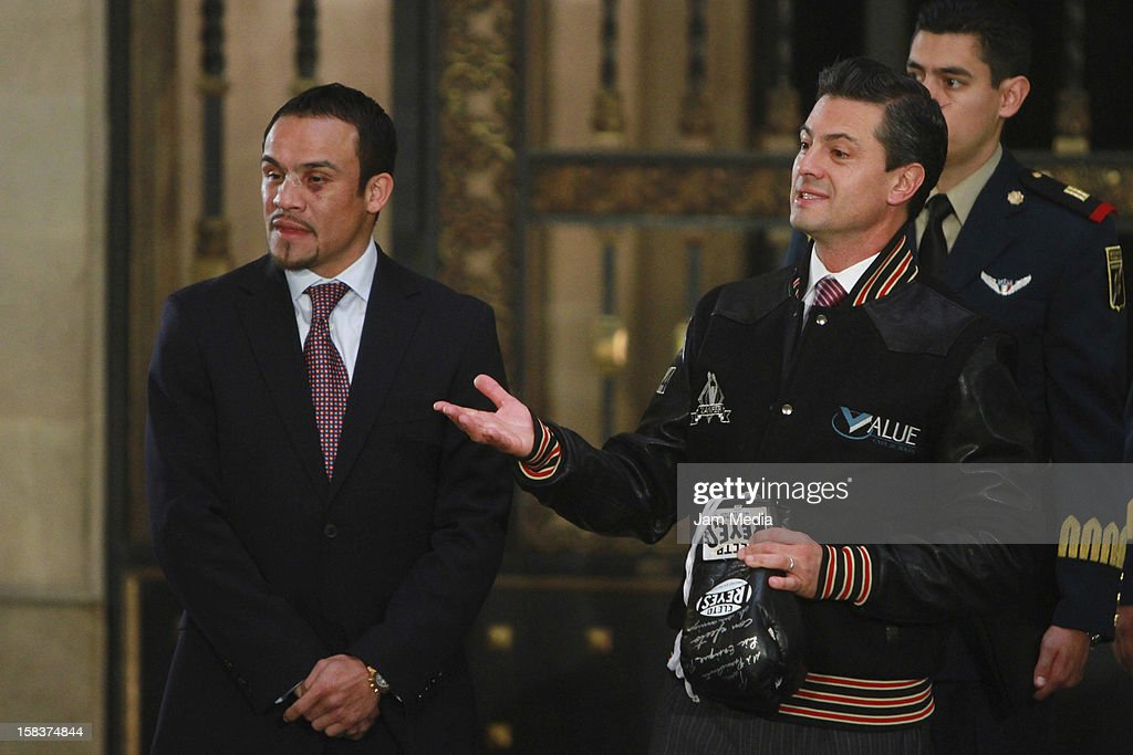 Boxer Juan Manuel Marquez and the President of Mexico <a gi-track='captionPersonalityLinkClicked' href=/galleries/search?phrase=Enrique+Pe%C3%B1a+Nieto&family=editorial&specificpeople=5957985 ng-click='$event.stopPropagation()'>Enrique Peña Nieto</a> pose at Palacio Nacional on December 14, 2012 in Mexico City, Mexico.