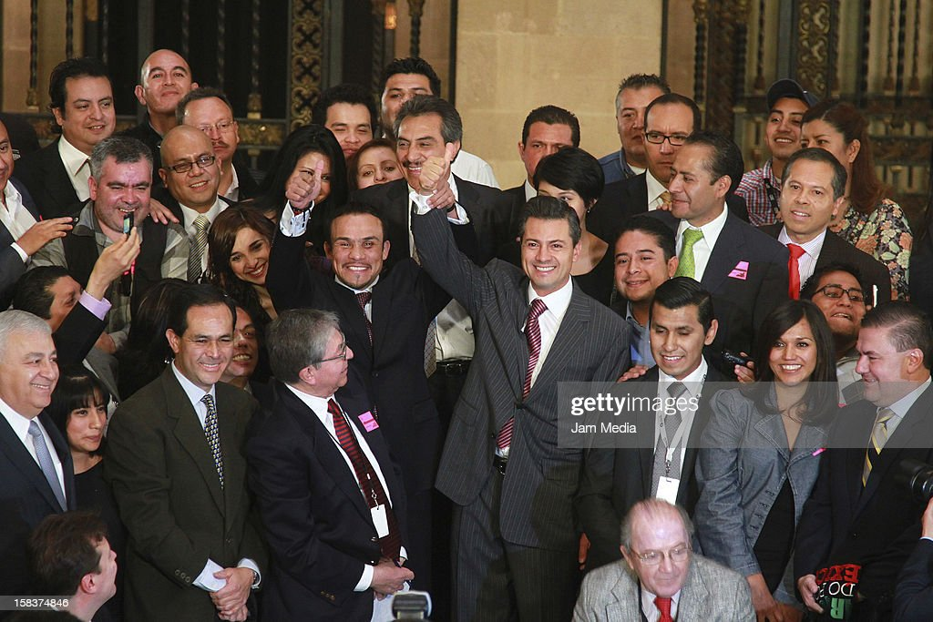 Boxer Juan Manuel Marquez and the president of Mexico <a gi-track='captionPersonalityLinkClicked' href=/galleries/search?phrase=Enrique+Pena+Nieto&family=editorial&specificpeople=5957985 ng-click='$event.stopPropagation()'>Enrique Pena Nieto</a> hold hands at Palacio Nacional on December 14, 2012 in Mexico City, Mexico