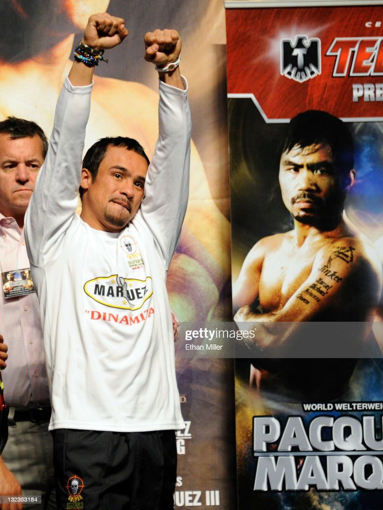 Boxer <a gi-track='captionPersonalityLinkClicked' href=/galleries/search?phrase=Juan+Manuel+Marquez&family=editorial&specificpeople=4202669 ng-click='$event.stopPropagation()'>Juan Manuel Marquez</a> appears on stage next to an image of Manny Pacquiao during the official weigh-in for his bout against Pacquiao at the MGM Grand Garden Arena November 11, 2011 in Las Vegas, Nevada. Pacquiao will defend his WBO welterweight title against Marquez when the two meet in the ring for the third time on November 12 in Las Vegas.