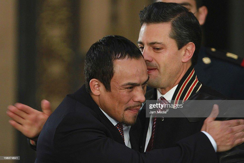 Boxer Juan Manuel Marquez hugs the President of Mexico Enrique Pena Nieto at Palacio Nacional on December 14, 2012 in Mexico City, Mexico.