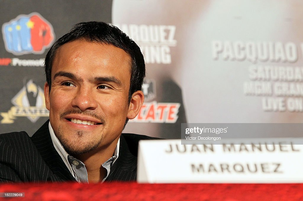 Boxer <a gi-track='captionPersonalityLinkClicked' href=/galleries/search?phrase=Juan+Manuel+Marquez&family=editorial&specificpeople=4202669 ng-click='$event.stopPropagation()'>Juan Manuel Marquez</a> smiles during the Manny Pacquiao v <a gi-track='captionPersonalityLinkClicked' href=/galleries/search?phrase=Juan+Manuel+Marquez&family=editorial&specificpeople=4202669 ng-click='$event.stopPropagation()'>Juan Manuel Marquez</a> - Press Conference at Beverly Hills Hotel on September 17, 2012 in Beverly Hills, California.