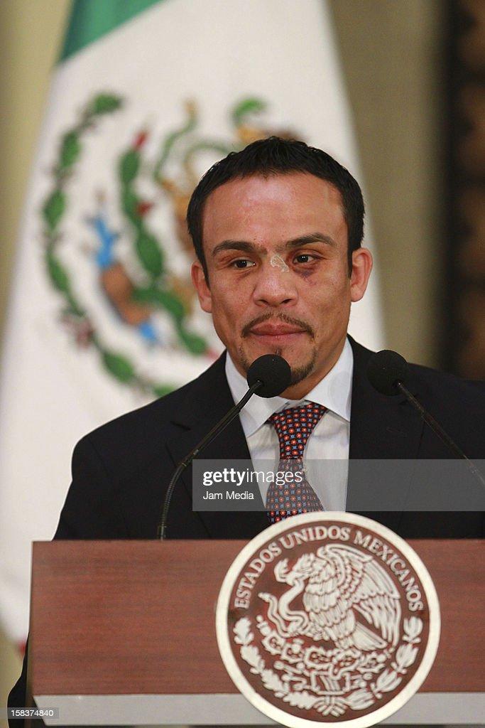 Boxer Juan Manuel Marquez speaks at Palacio Nacional on December 14, 2012 in Mexico City, Mexico