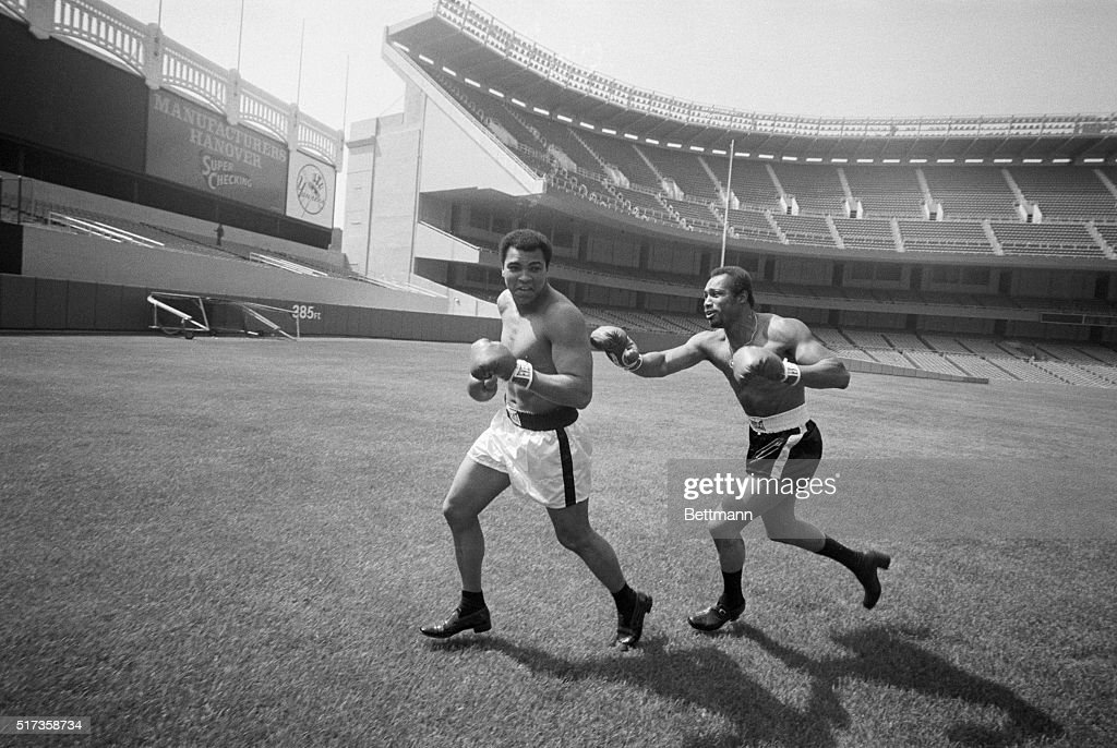 Boxer Ken Norton playfully chases World Heavyweight Boxing Champion Muhammad Ali in a game of tag across the field at Yankee Stadium. Norton lost the title fight to Ali at the stadium on September 28, 1976.