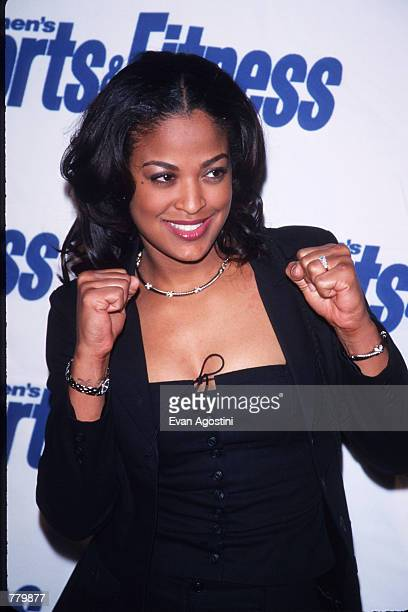 Boxer Laila Ali poses for a picture February 8 2000 at an awards ceremony in the USA Ali is set to fight Crystal Arcand on March 7 at Casino Windsor...