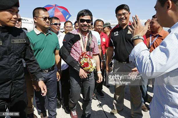 Boxer Manny Pacquiao arrives in his hometown on May 15 2015 in General Santos Philippines Pacquiao lost on May 3 during his title unification fight...