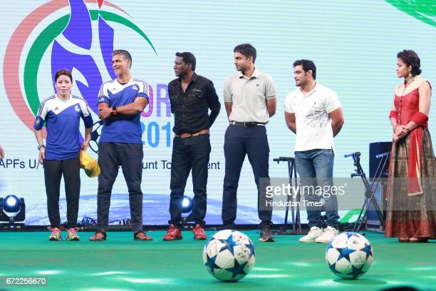 Boxer Mary Kom actor Milind Soman former footballer IM Vijayan Badminton coach Pullela Gopichand and wrestler Sushil Kumar during the launch of Oorja...