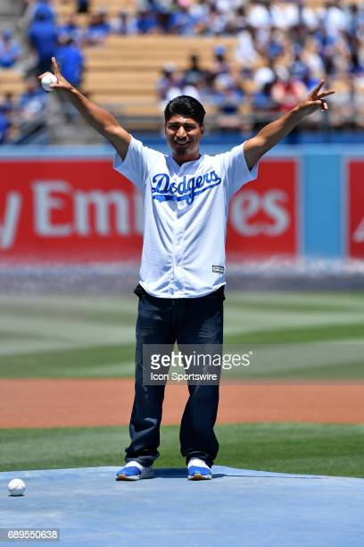 Boxer Miguel Angel Garcia Cortez throws out the first pitch before an MLB game between the Chicago Cubs and the Los Angeles Dodgers on May 28 at...