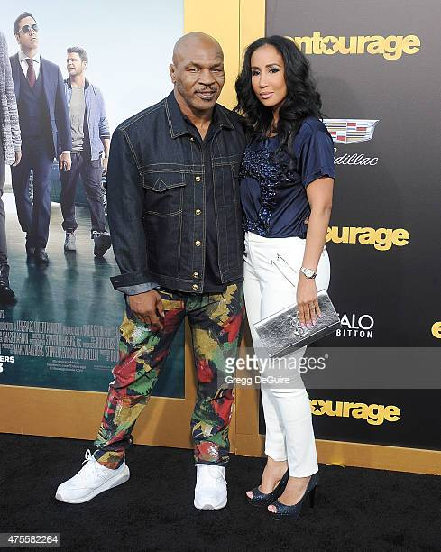 Boxer Mike Tyson and Lakiha Spicer arrive at the Los Angeles premiere of 'Entourage' at Regency Village Theatre on June 1 2015 in Westwood California