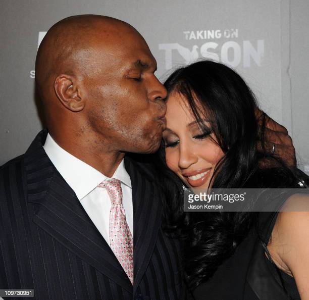 Boxer Mike Tyson and wife Lakiha Spicer attend the 'Taking on Tyson' New York premiere at Gansevoort Park Avenue on March 2 2011 in New York City