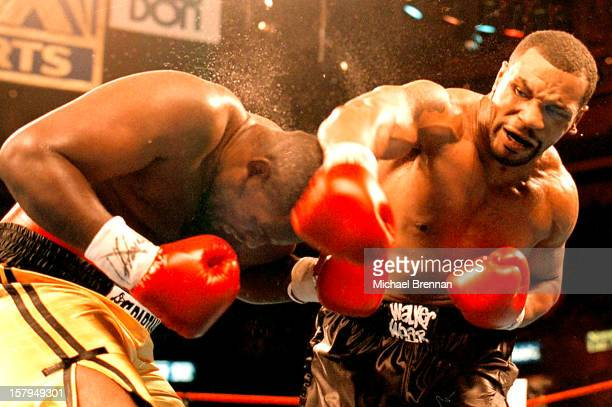 Boxer Mike Tyson lands a right on the head of Buster Mathis Jr during a fight in Philadelphia 16th December 1995
