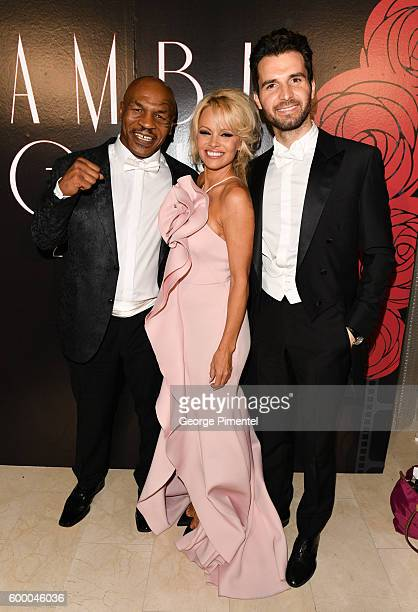 Boxer Mike Tyson Pamela Anderson and AMBI Pictures Andrea Iervolino attend the 2016 Toronto International Film Festival 'AMBI Gala' at Ritz Carlton...