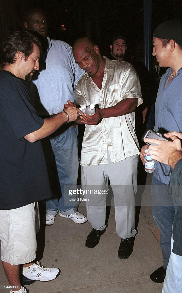 Boxer Mike Tyson signs autographs at the Latin Lounge August 28, 2003 in West Hollywood, California.