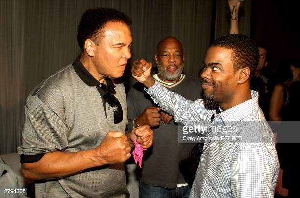 Boxer Muhammad Ali and Comedian/Actor Chris Rock and Photographer Howard L Bingham photographed during Art Basel Taschen book premiere of Muhammad...
