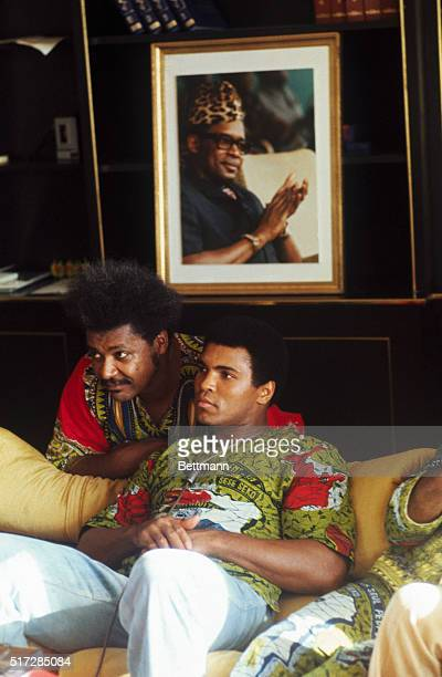Boxer Muhammad Ali and fight promoter Don King in Ali's villa with a portrait of Mobutu on the wall behind them
