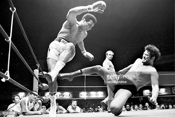 Boxer Muhammad Ali fights with wrestler Antonio Inoki at Nihon Budokan on June 26 1976 in Tokyo Japan