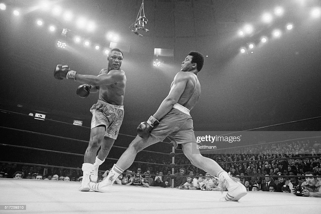 Boxer Muhammad Ali steps away from a punch thrown by boxer Joe Frazier during their heavyweight title fight at Madison Square Garden in 1971 Frazier...
