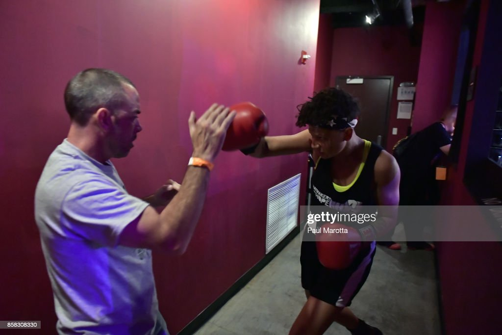 Boxer Natasha Moustache warms up and prepares with her trainers prior to her bout at the Haymakers for Hope Fundraiser - 2017 Belles of the Brawl at House of Blues Boston on October 5, 2017 in Boston, Massachusetts. Organizers estimate app. $450,000 was raised with this single event in Boston nd more than $7.5m since its inception. Amature boxers train for four months with professional trainers and step into the ring to fight a professionally organized boxing match to raise money and awareness for cancer research.