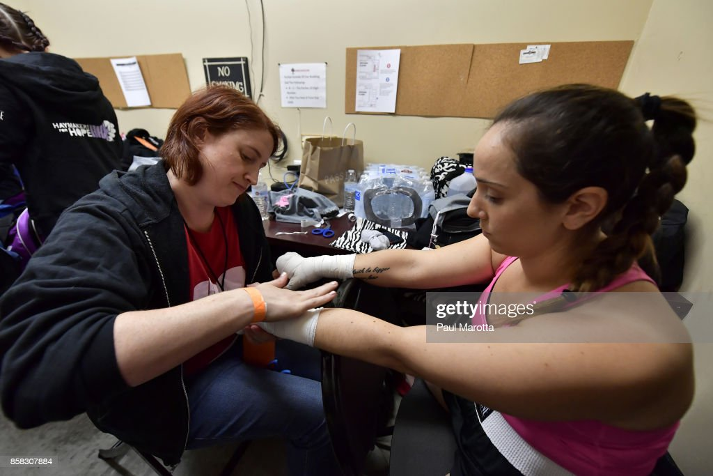 Boxer Nicole Bezreh has her hands wrapped by her trainer Jessica Smith prior to her bout at the Haymakers for Hope Fundraiser - 2017 Belles of the Brawl at House of Blues Boston on October 5, 2017 in Boston, Massachusetts. Organizers estimate app. $450,000 was raised with this single event in Boston nd more than $7.5m since its inception. Amature boxers train for four months with professional trainers and step into the ring to fight a professionally organized boxing match to raise money and awareness for cancer research.