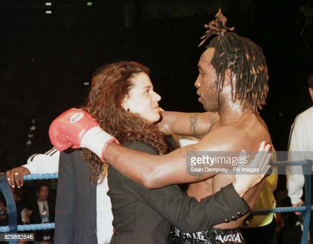 Boxer Nigel Benn gets a hug from gitlfriend Caroline after he retired himself in the sixth round of his WBO Supermiddleweight title fight against...