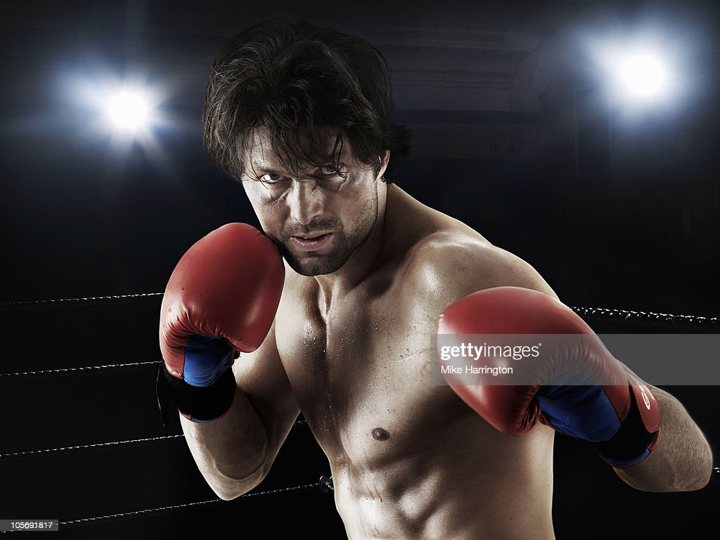 Boxer Preparing To Punch : Stock Photo
