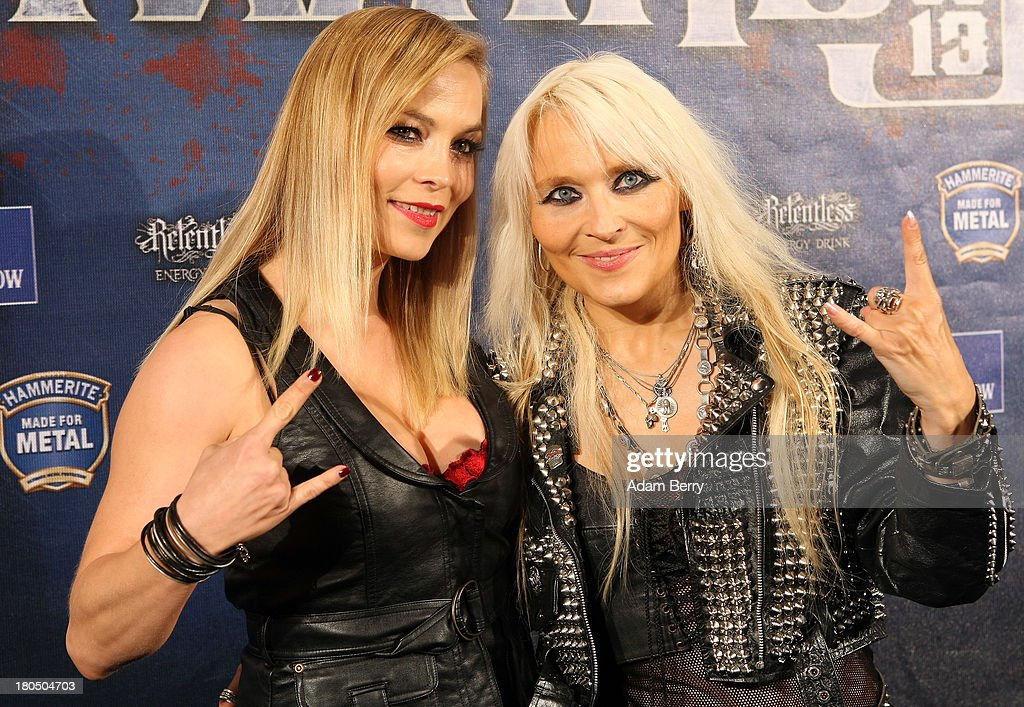 Boxer Regina Halmich (L) and Singer Doro arrive for the fifth Metal Hammer Awards at Kesselhaus on September 13, 2013 in Berlin, Germany. The annual prizes are given by Metal Hammer, a German music magazine specialized in Heavy Metal and Hard Rock.