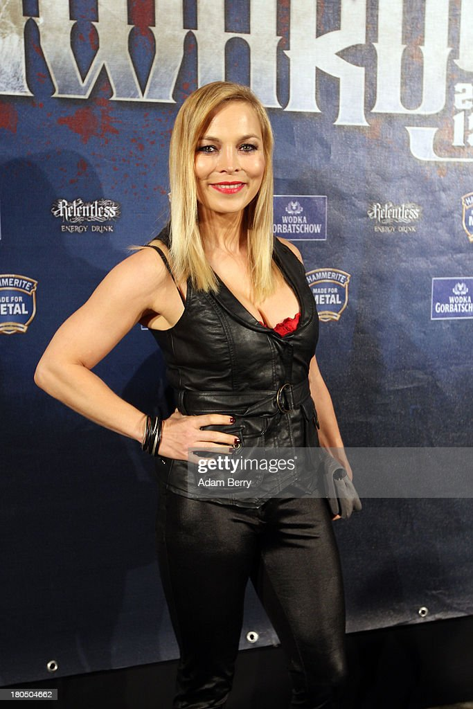 Boxer Regina Halmich arrives for the fifth Metal Hammer Awards at Kesselhaus on September 13, 2013 in Berlin, Germany. The annual prizes are given by Metal Hammer, a German music magazine specialized in Heavy Metal and Hard Rock.
