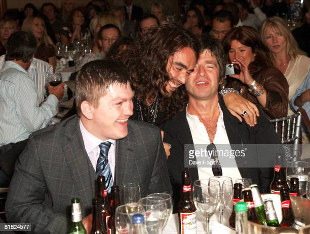 Boxer Ricky Hatton comedian Russell Brand and Oasis member Noel Gallagher attend the auction at The O2 Silver Clef Awards Luncheon in aid of...