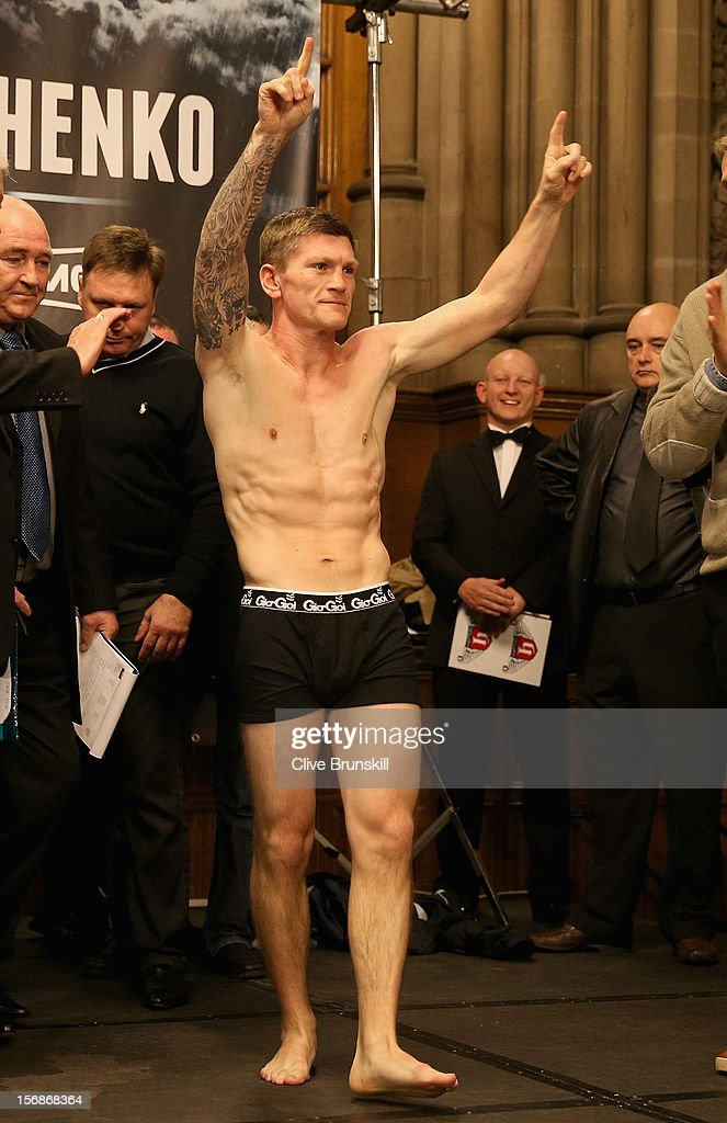 Boxer <a gi-track='captionPersonalityLinkClicked' href=/galleries/search?phrase=Ricky+Hatton&family=editorial&specificpeople=208674 ng-click='$event.stopPropagation()'>Ricky Hatton</a> salutes his fans as he walks on stage to weigh in prior to his bout with Vyacheslav Senchenko at at the Manchester Town Hall on November 23, 2012 in Manchester, England. Hatton has his comeback fight against Vyacheslav Senchenko on November 24th.