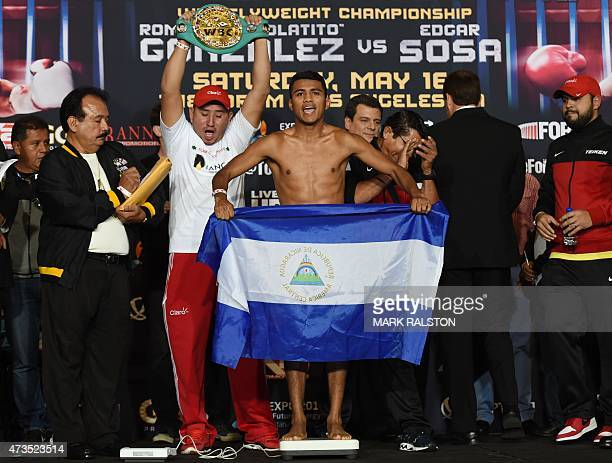 Boxer Roman Gonzalez of Nicaragua holds his national flag during the weighin before his WBC Flyweight World Championship bout against Edgar Sosa of...