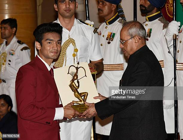 Boxer Shiv Thapa receives Arjun Award 2016 from President Pranab Mukherjee at the Sports and Adventure Awards 2016 at Rashtrapati Bhawan on August 29...