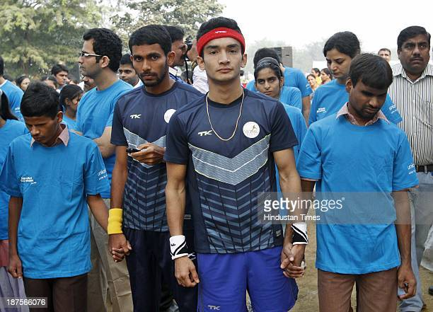 Boxer Shiv Thapa with visually impaired take part in the 19th edition of CocaCola Salwan Cross Country Run at Brar Square Delhi Cantt on November 10...