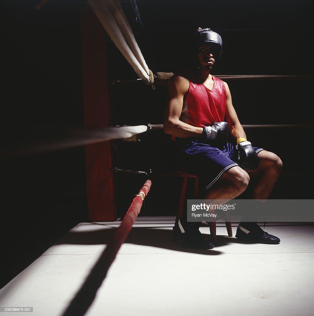 Boxer sitting in corner of boxing ring, portrait : Stock Photo