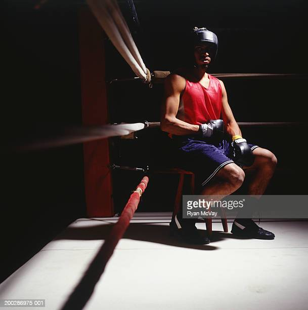 Boxer sitting in corner of boxing ring, portrait