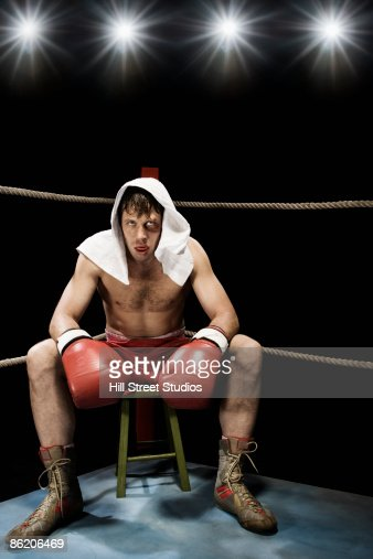 Boxer Sitting On Stool In Corner Of Boxing Ring Stock