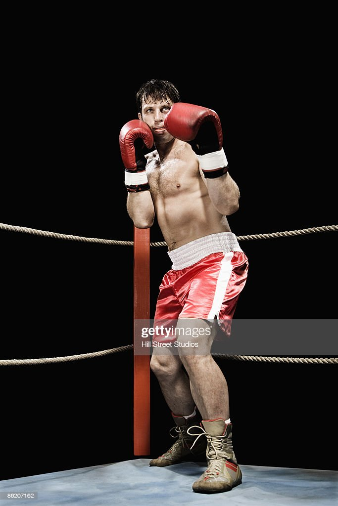 Boxer standing in fighting stance in boxing ring : Stock Photo
