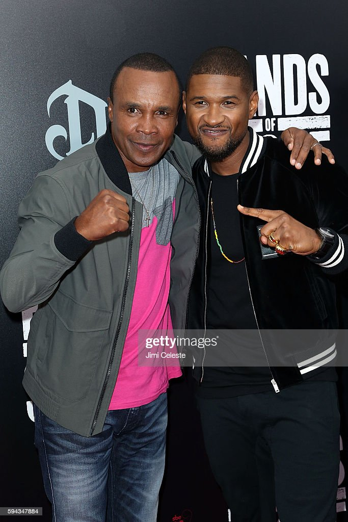 Boxer Sugar Ray Leonard and Singer Usher attend The Weinstein Company Presents the US Premiere of 'Hands of Stone' at SVA Theater on August 22 2016...