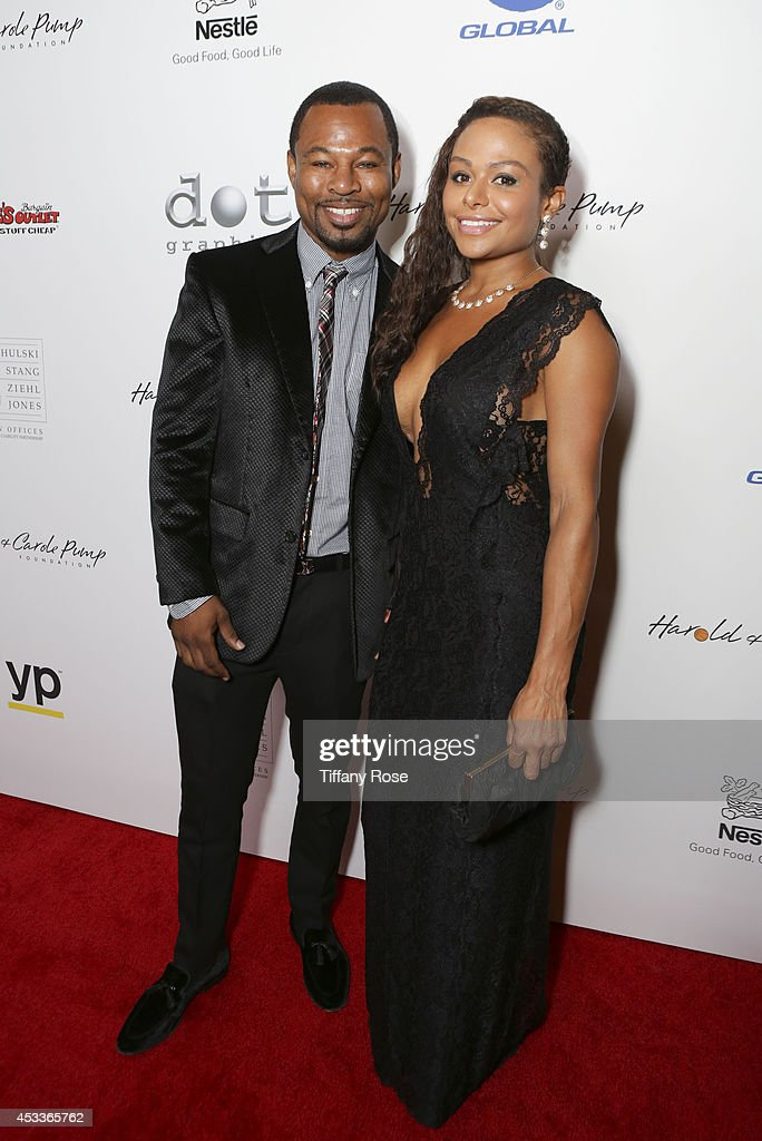 Boxer Sugar Shane Mosley and Bella Gonzalez attend the 14th Annual Harold & Carole Pump Foundation Event on August 8, 2014 in Los Angeles, California.