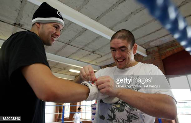 Boxer Tony Bellew enjoys a light moment with trainer Anthony Farnell during a training session at Former WBU Middleweight Champion Anthony Farnell's...